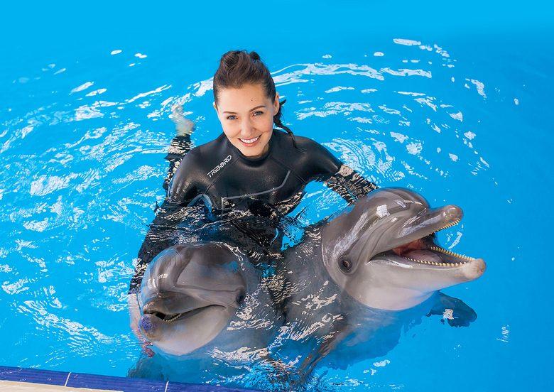 Що означає плавати з дельфінами у сні: тлумачення за різними сонникам